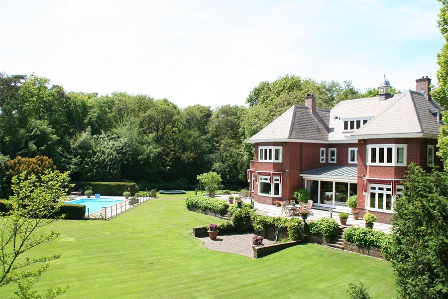 The charming gardens of this Dutch home just south of Haarlem are partially shaded by mature trees. In midday, an Impressionist play of light and shadow dances across the property.