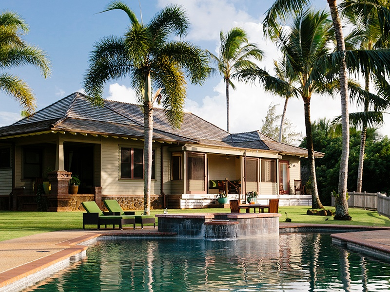 """To achieve """"a fluid integration"""" with its surroundings, the home on Kauapea Road draws design elements from traditional craftsman-style houses and tropical plantations."""