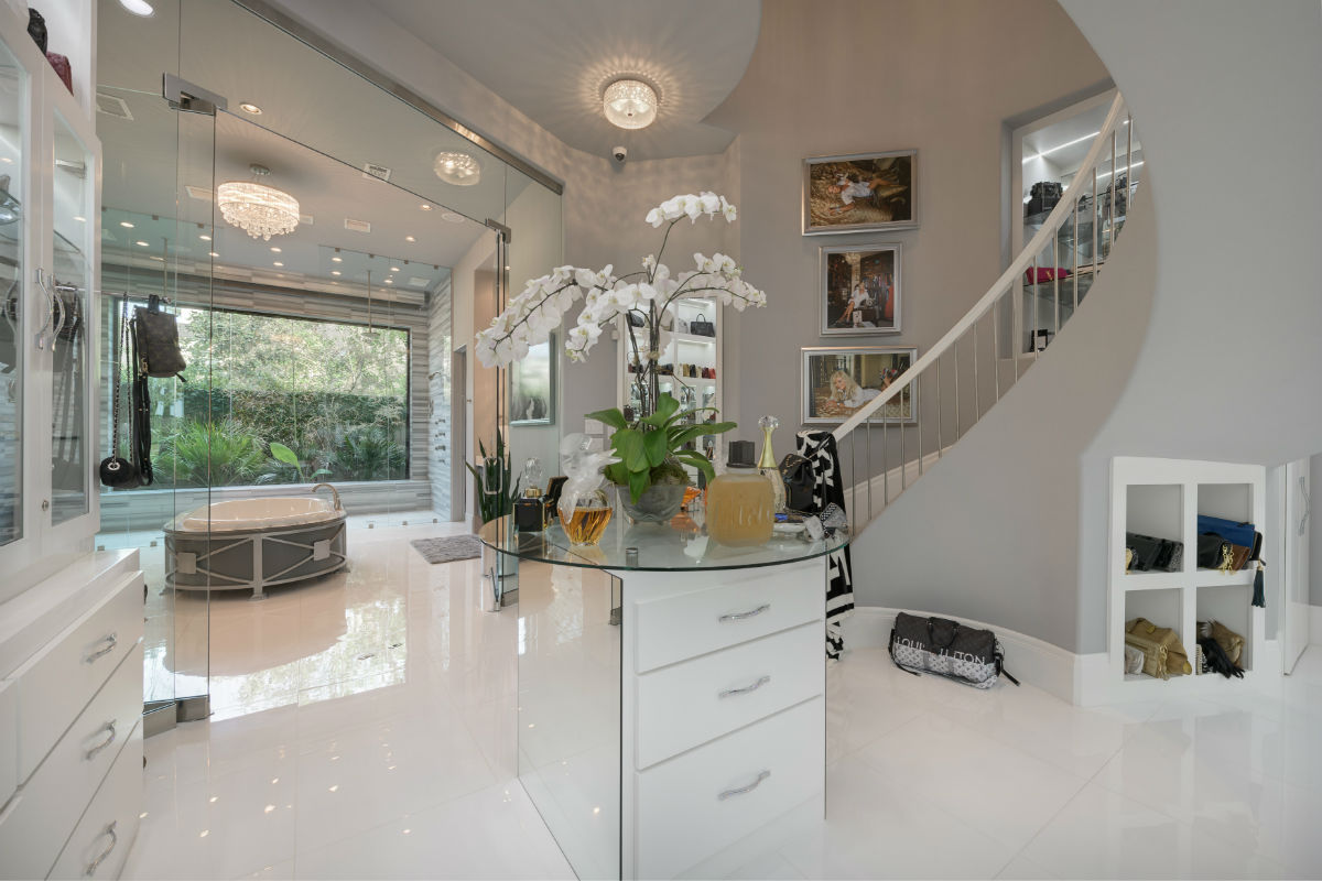 """A fashionista's dream, this lavish home's three-story """"wardrobe"""" is akin to a luxury boutique and even has its own cocktail bar."""