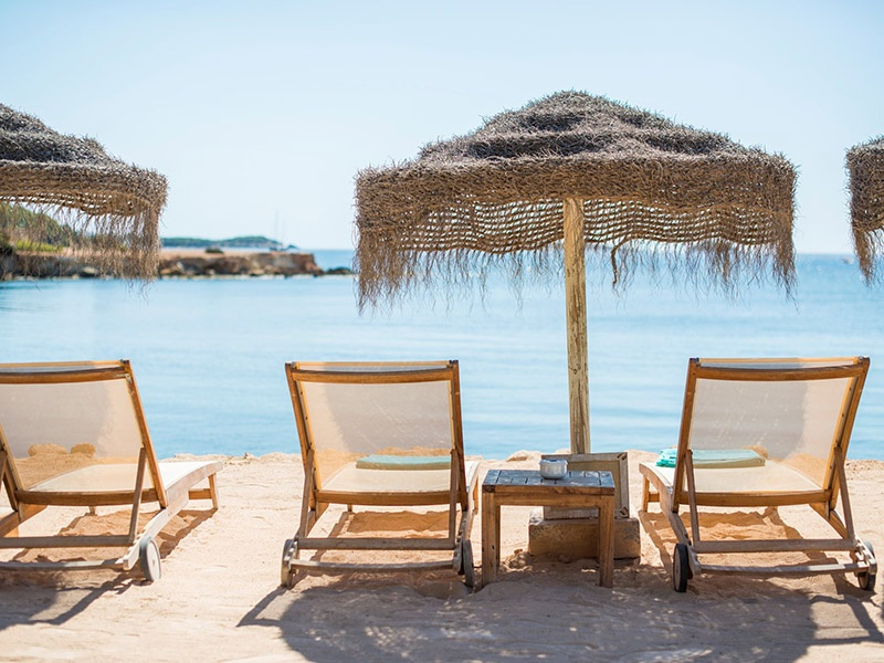 Babylon Beach Bar, overlooking the sea on Ibiza's northeast coast, is the ultimate retreat. Photograph: White Ibiza. Banner image: Getty Images