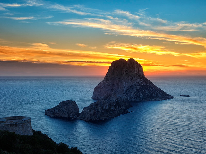 Towering 1,300 feet high, Es Vedrà is shrouded in mystery and is even said to be the gateway to Atlantis. Photograph: Getty Images