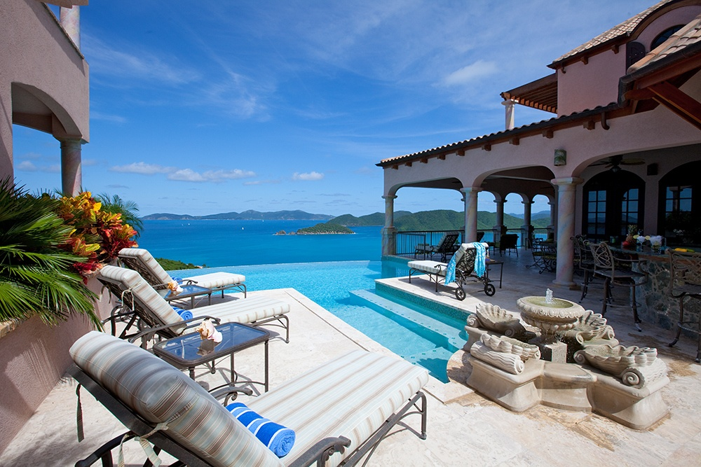 Virgin Islands National Park is the paradisal setting for this grand villa overlooking the surrounding forest canopy and azure Caribbean seas.