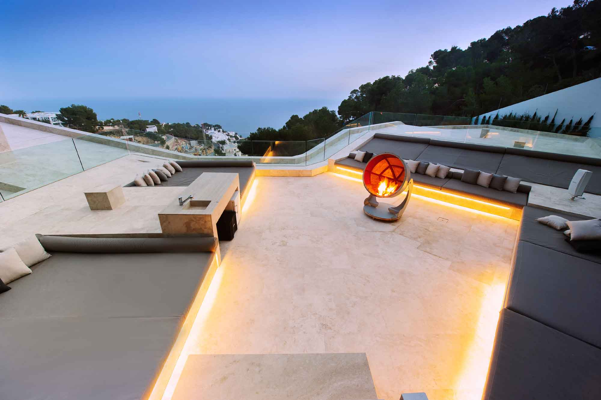 This unique five-bedroom, six-bathroom Ibizan villa uses glass to blur the lines between the land and the sea.