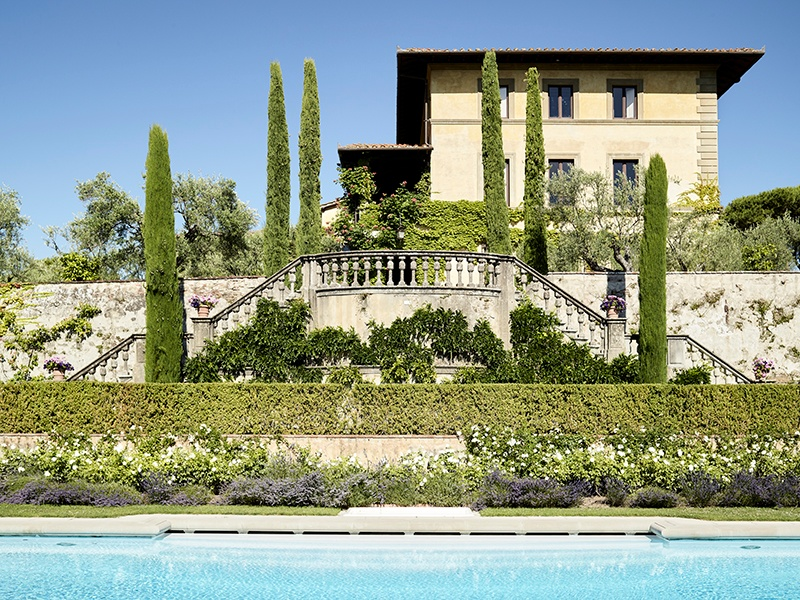 Formal Italian gardens and a swimming pool are overlooked by the main house at Il Palagio. Photograph: Fabrizio Cicconi