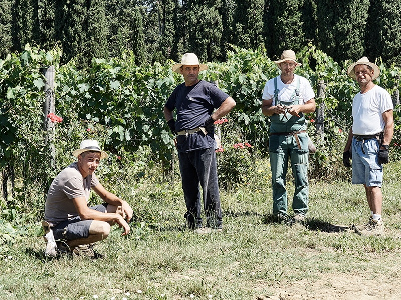 The vineyard team take a break from their hard work—all are local to Il Palagio, coming in from villages surrounding the Tuscan estate. Photograph: Fabrizio Cicconi