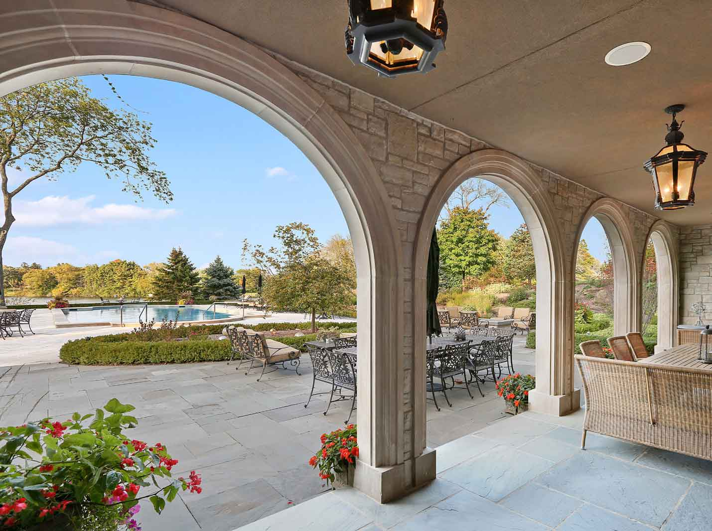 Designed for lavish entertaining, this estate in prestigious Barrington Hills is a vision of Gilded Age splendor with its sumptuous pool terrace, exquisite gardens, and two beautiful lakes.
