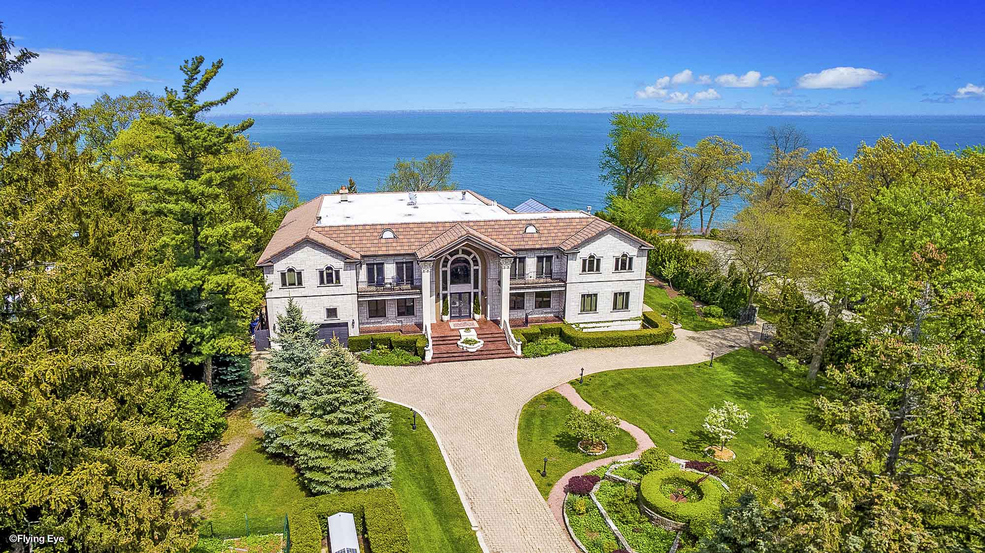 This elegant home in Highland Park was designed with massive arched windows which take advantage of its glorious setting on the shores of Lake Michigan.