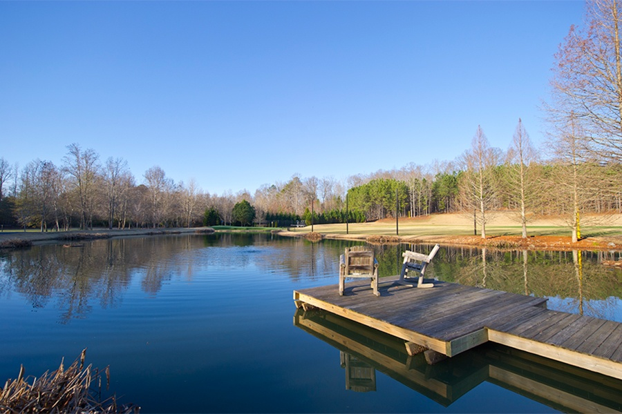 The estate's pond with its charming wooden dock is ideal for a low-key afternoon of fishing.