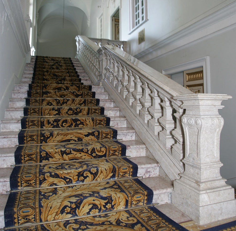 Much of Castle Po's historic interior detail, including a grand carved marble staircase, has been carefully restored.