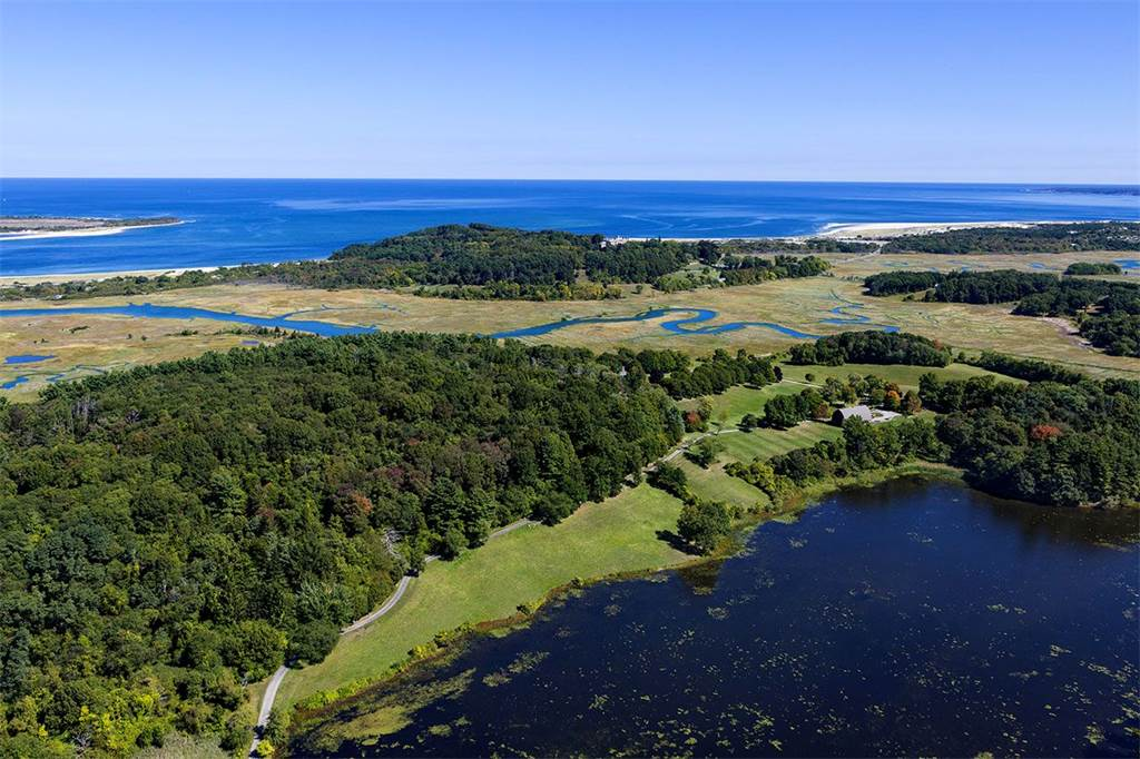 This unique and ultimately private waterfront estate in the historic coastal town of Ipswich, Massachusetts, comprises 284 acres of coastal marshland, meadows, and woodland; a stately main residence; an original colonial house; and a New England barn.