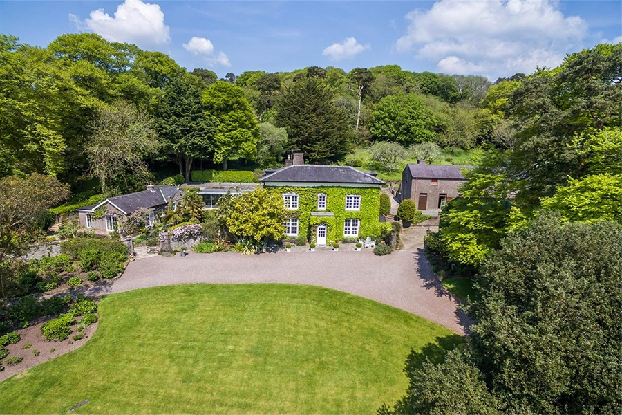 This County Cork estate with five buildings and equestrian facilities is perched atop a hill overlooking the lush Irish countryside.