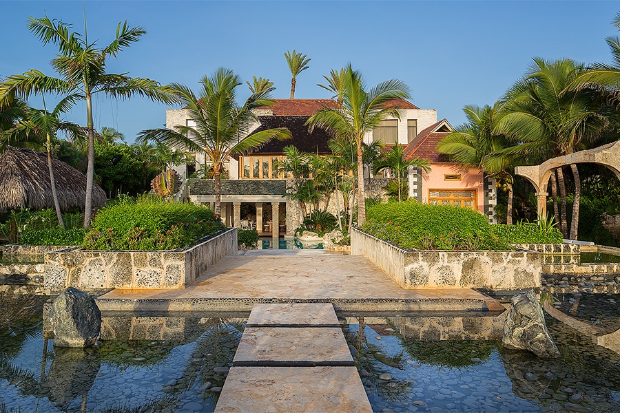 This island retreat in Cap Cana, Dominican Republic, is a botanical wonderland where ocean views and rustling palm trees are the only sights and sounds. It combines the elegance of formal landscaping with the tropical style of a classic South American garden.