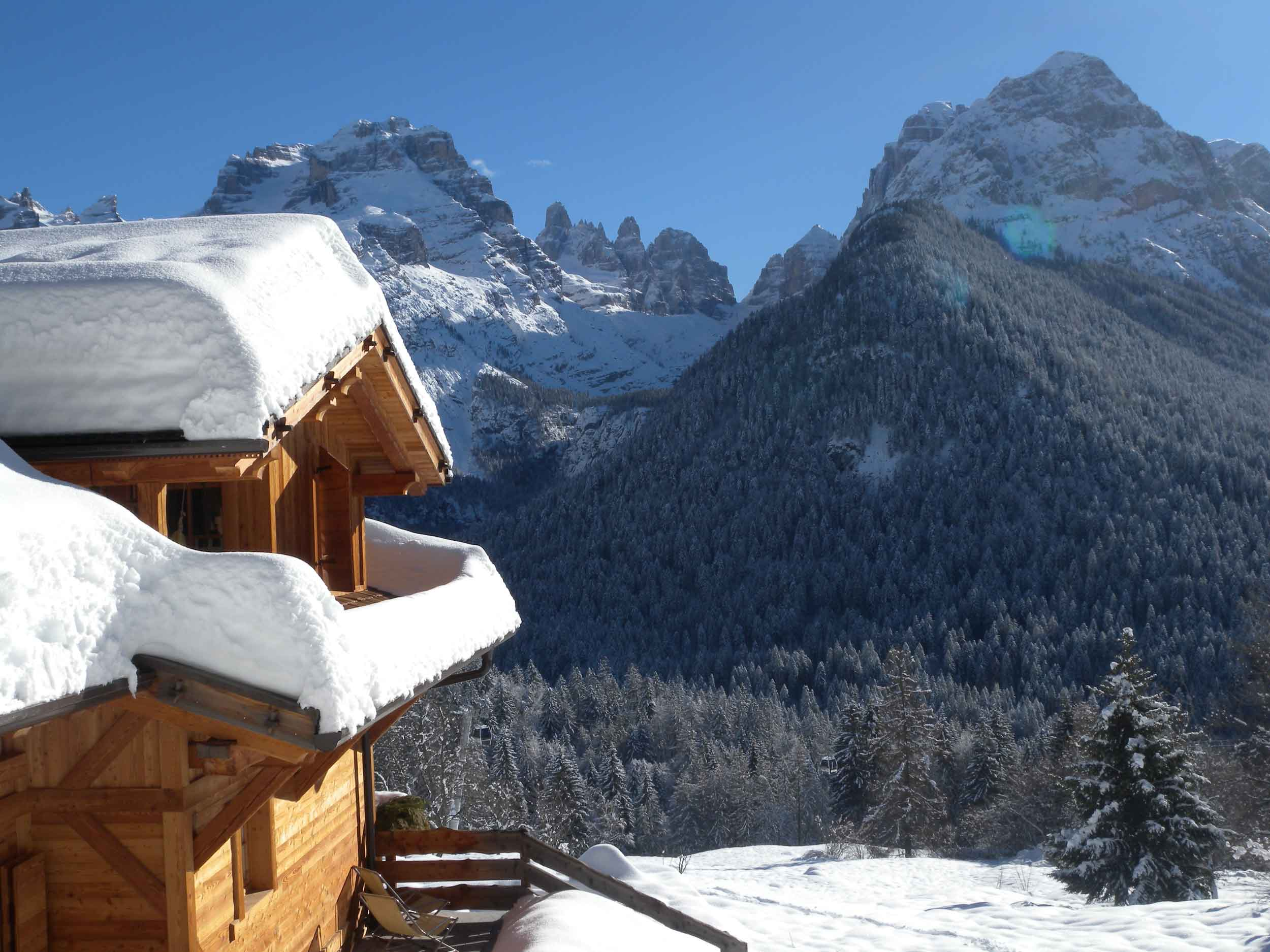 The Brenta Dolomites form the dramatic backdrop to this eco-friendly Alpine chalet, 3 km from the village and winter resort of Madonna di Campiglio.
