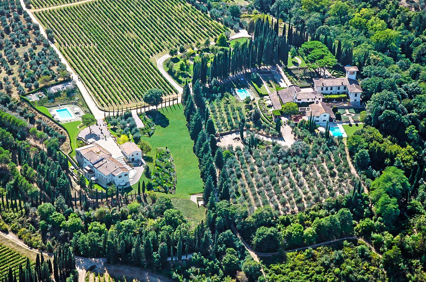 Bounded by cypresses, vineyards, olive groves, and ancient forests, this historic estate overlooks the Chianti Classico hills, in the heart of the Tuscan countryside.