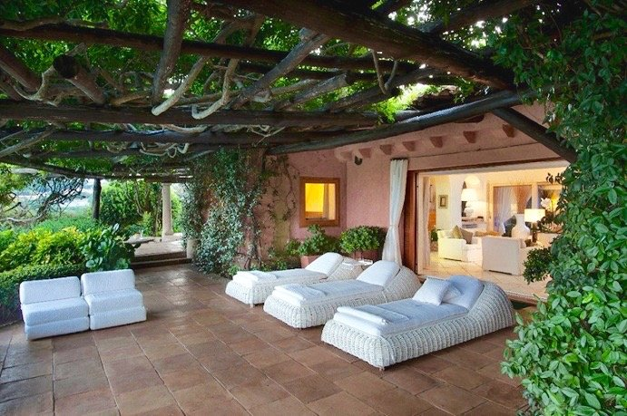 It's easy to imagine fairies or a little Italian household spirit, a monaciello, flitting about while one dozes on a warm afternoon beneath this vine-covered bower.