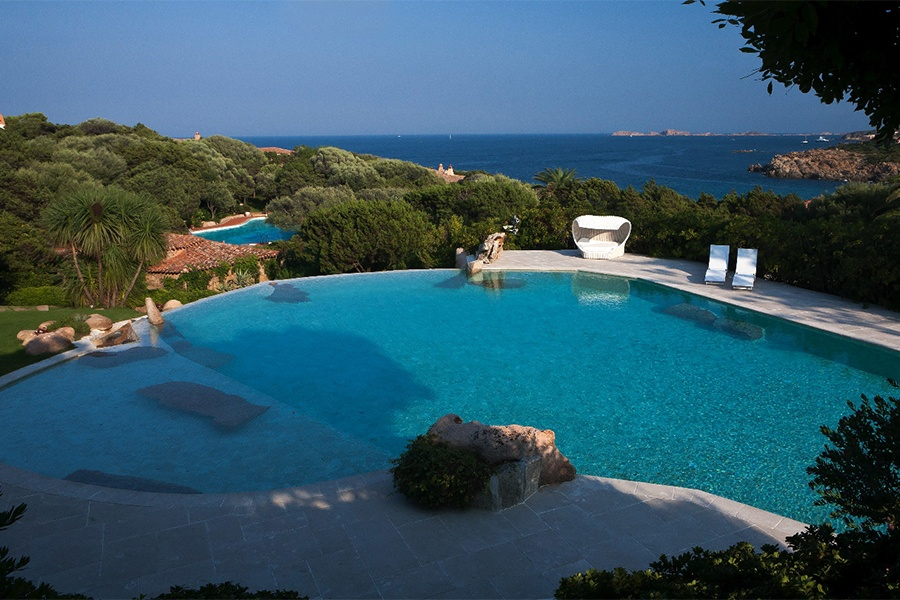 The timeless sea view across the wooded grounds of this Mediterranean villa invites relaxed contemplation.