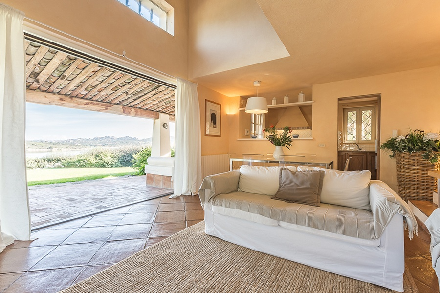 Villa Giulia has a classic, Mediterranean-style interior with tile floors, a warm color palette, rustic beams, and of course, breathtaking views of Porto Rafael and Costa Serena, a haven for serious sailors.