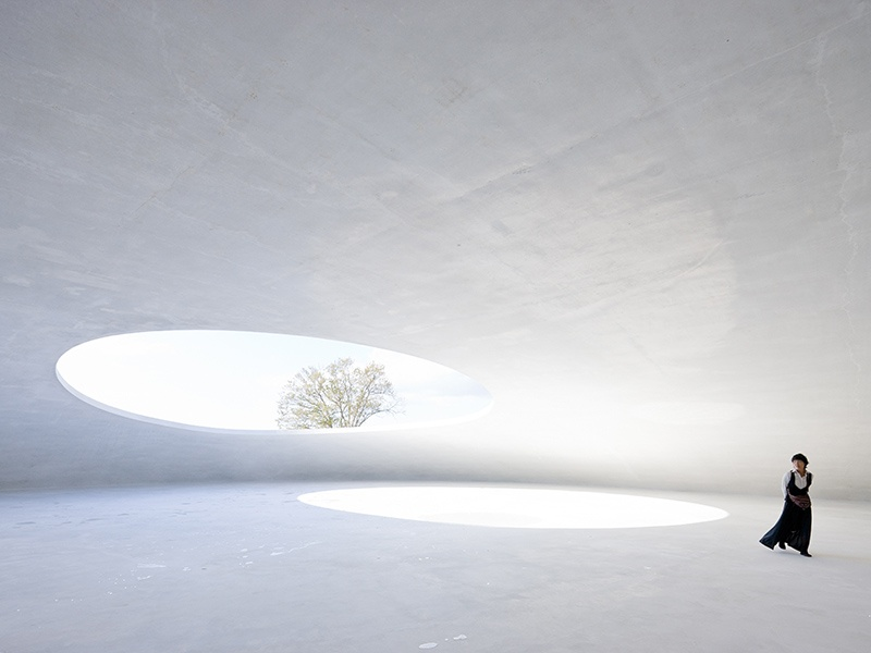Teshima Art Museum on the island of Teshima, Japan, makes use of open spaces and light in a way that perfectly complements Iwan Baan's photographic style. The museum was designed by architect Ryue Nishizawa and contains a single artwork, <i>Matrix</I>, by the sculptor Rei Naito. Photograph: Iwan Baan.