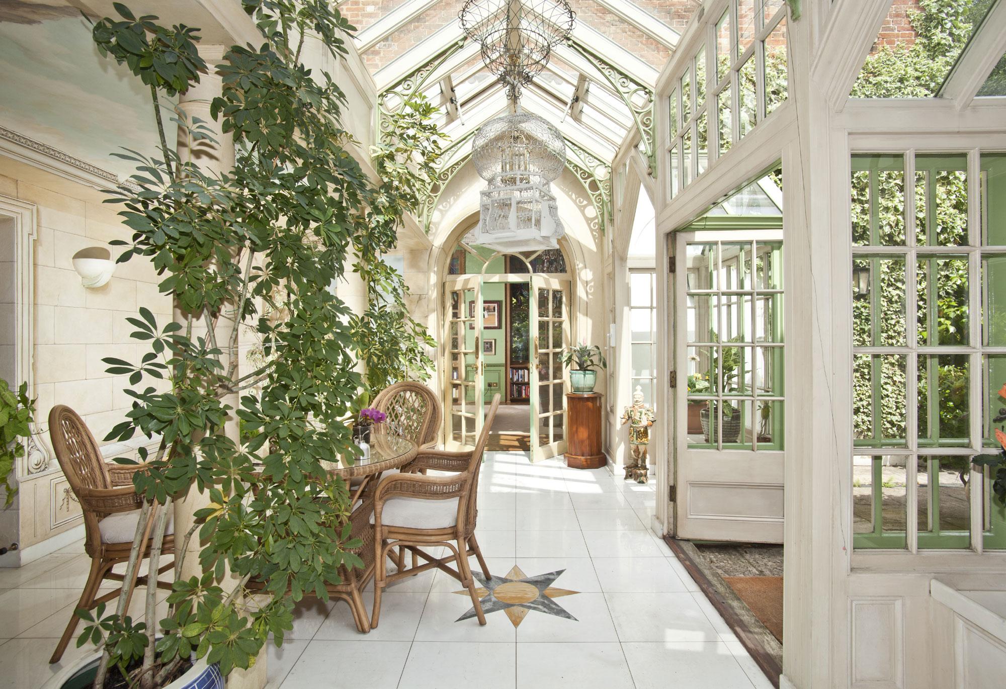 John Gays House, a Tudor estate in the Berkshire village of Holyport, has an elegant conservatory overlooking splendid formal gardens.