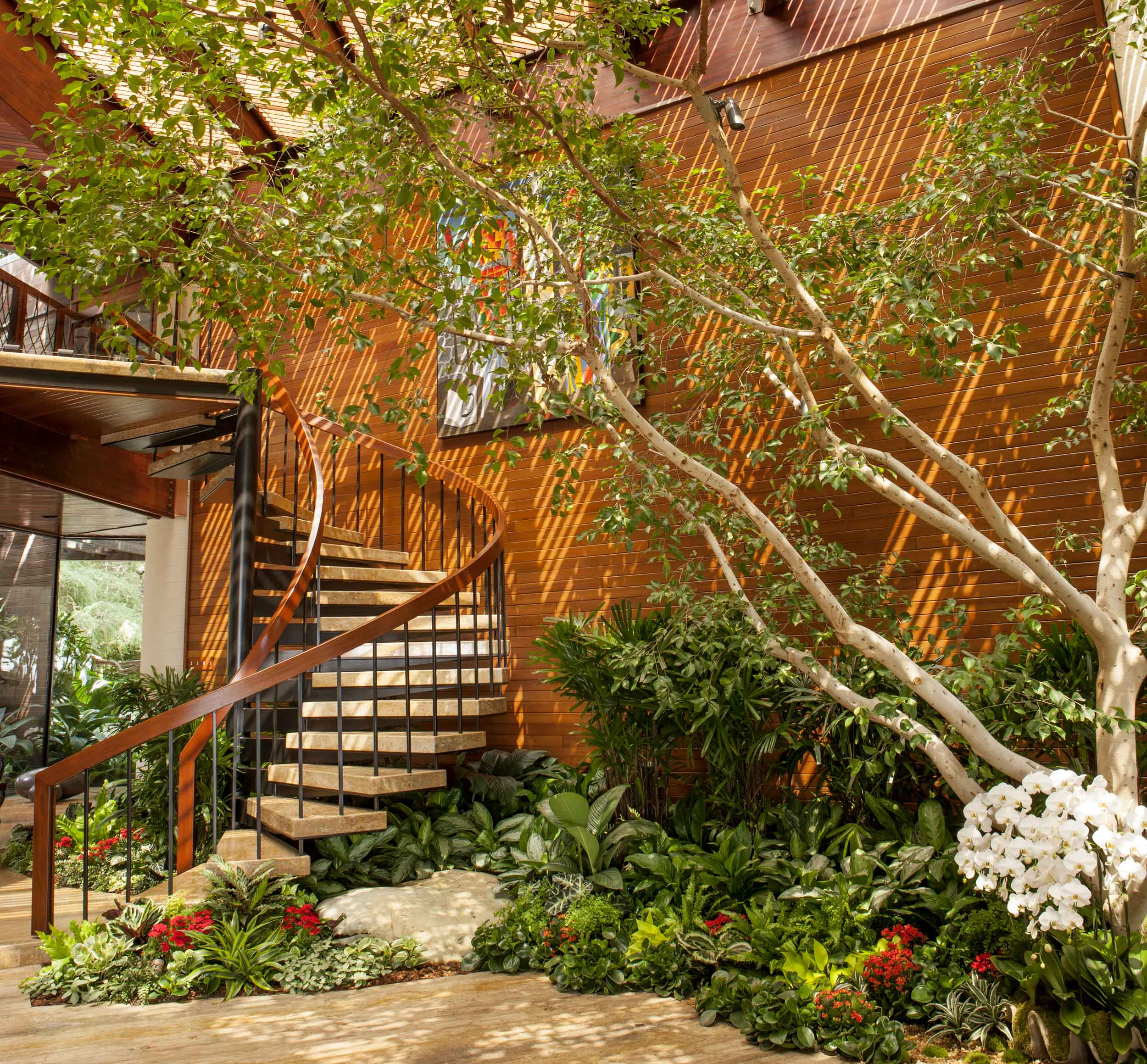 Another sweeping vertical view of the main floor illustrates how the natural light fosters an indoor arboretum.