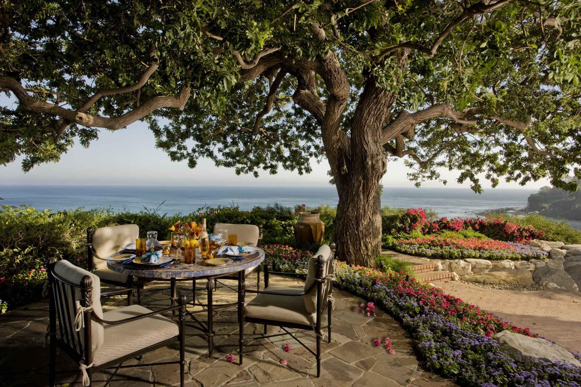This terraced patio faces iconic Pt. Dume in the distance, and can serve as an open-air breakfast-nook.