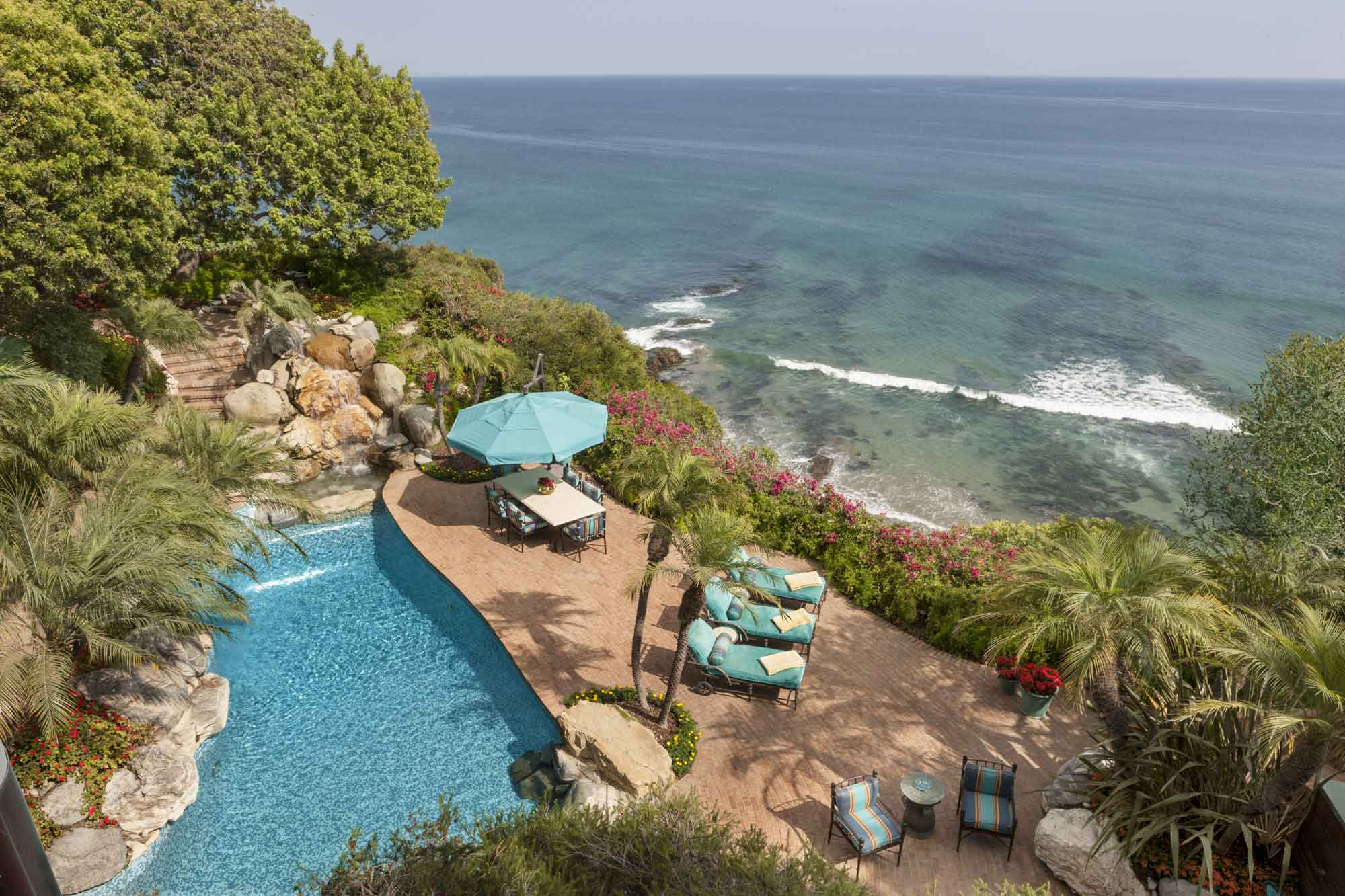 The estate's swimming pool overlooks the Pacific from the south-facing vantage of Point Dume.