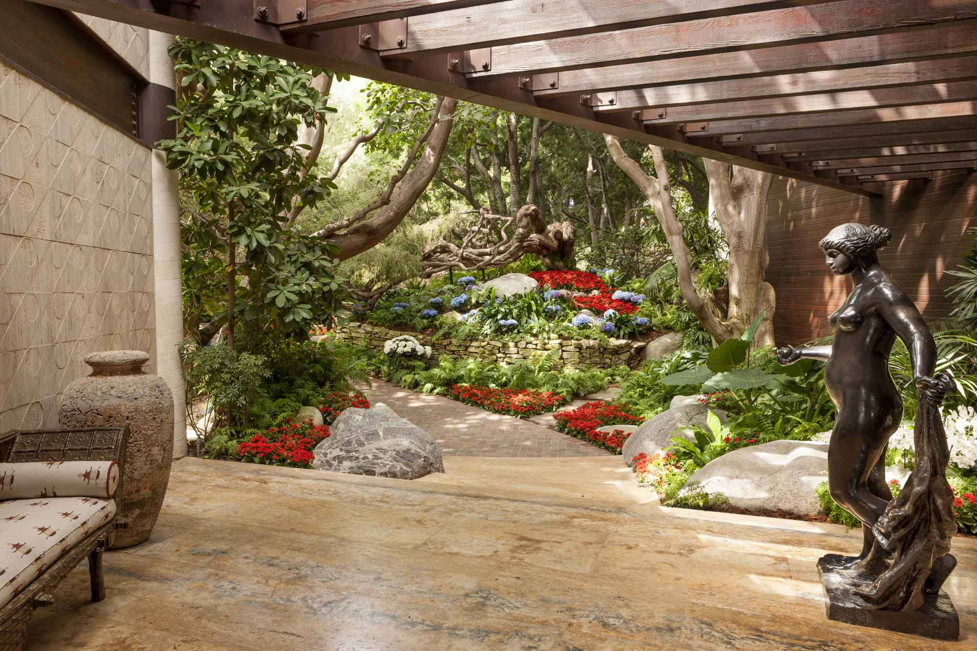 Lush landscaping outside blends seamlessly with the indoors—a hallmark of the home's design.