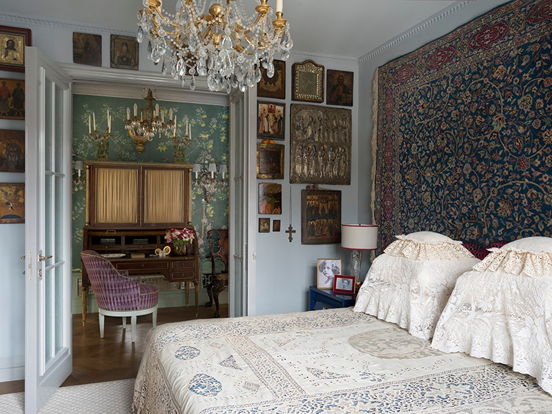 Fine lace, a majestic tapestry, and a rare collection of icons make the master bedroom of this apartment a Pushkin-inspired dream. Photograph: Kirill Istomin Interior Design