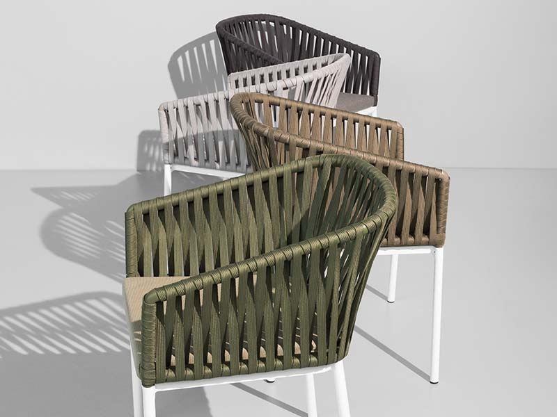 Bitta dining chairs by Kettal, formed from dense, weatherproof braiding, on aluminum frames, are reminiscent of a boat's ropes for mooring – or <i>bitta</i> in Italian. Available in four colors.