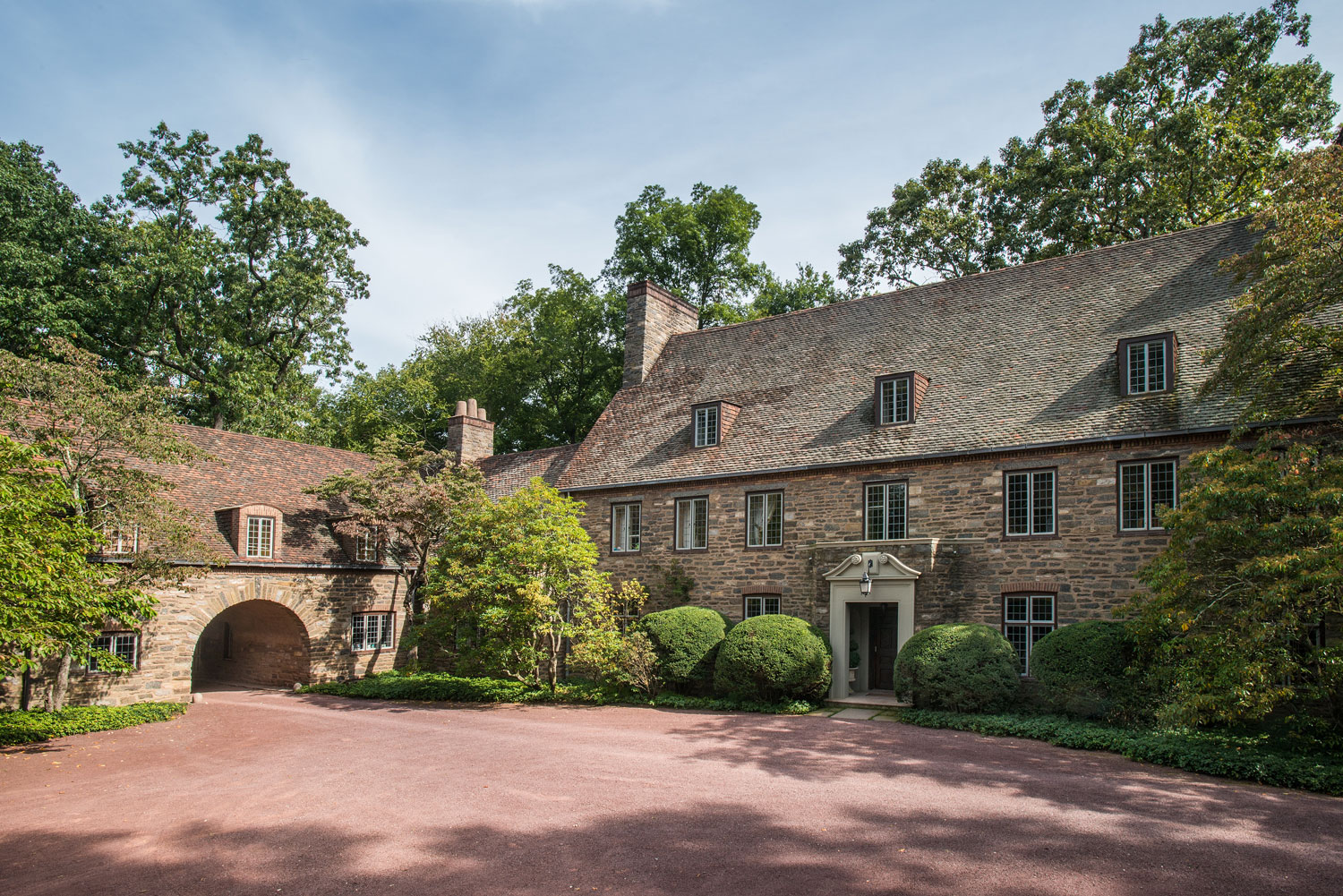This 1927 stone manor by illustrious architect H.T. Lindeberg has a memorable setting on 8.6 acres of grounds in one of the most exclusive areas of Greenwich, Connecticut.