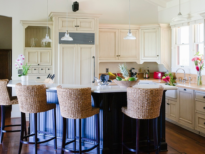 Even the kitchen, which features a Sub-Zero refrigerator, a vintage-style range, and marble countertops, enjoys ocean views.