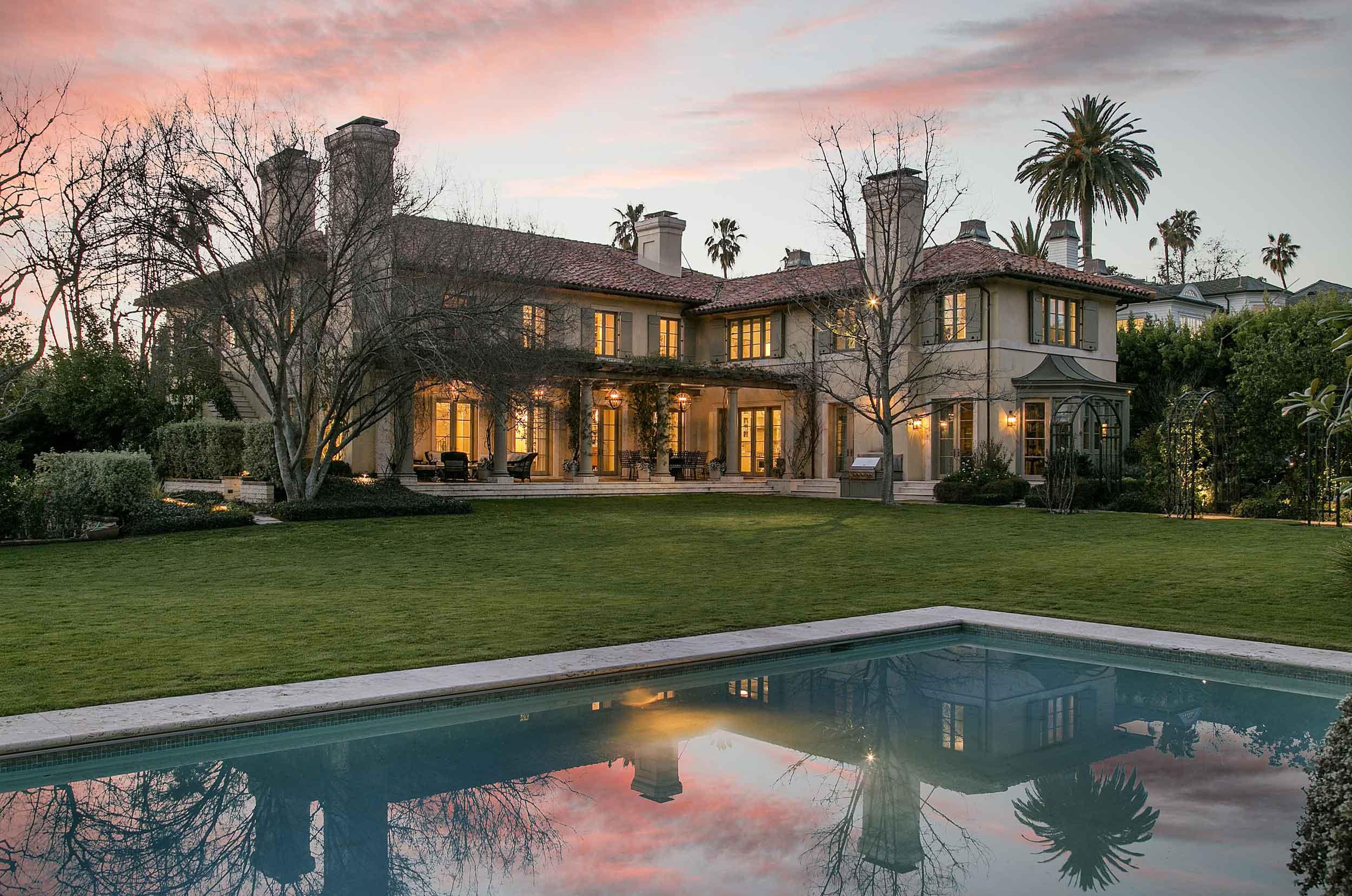 Villa Burlingame, Jim Belushi's magnificent Brentwood estate, invites glamorous living and grand entertaining with its authentic Provençal-inspired architecture and serene 1.3-acre grounds.