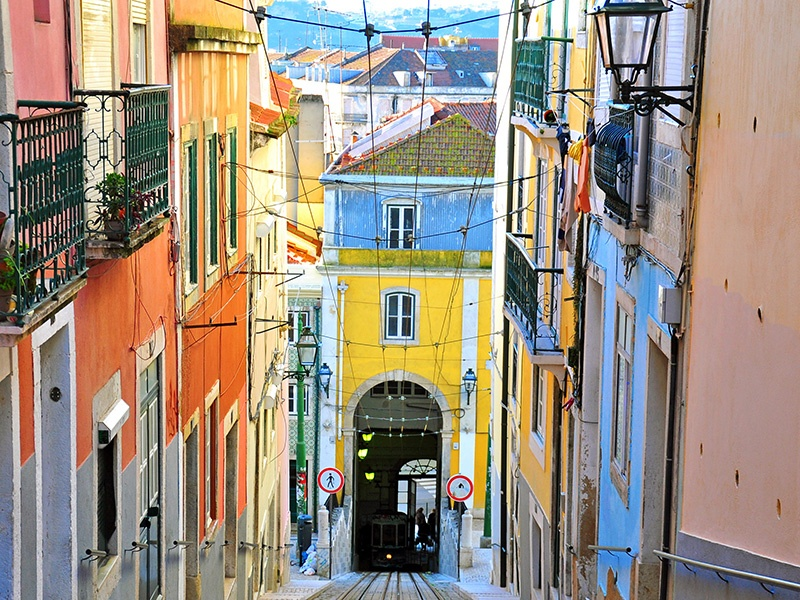 Some of Lisbon's hidden-away, authentic bars and cafés can be found among the narrow, cobbled streets in the Bairro Alto. Photograph: Alamy