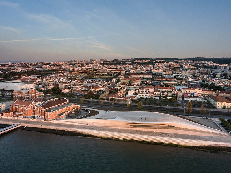 The MAAT, and the renovated Tejo Power Station, seen here on the left, have revitalized Lisbon's Belém district. Photograph: ©Fernando Guerra. Courtesy of the EDP Foundation. Banner image: The tiled façade of the MAAT evokes Portugal's ceramics heritage. ©Hufton+Crow. Courtesy of AL_A.