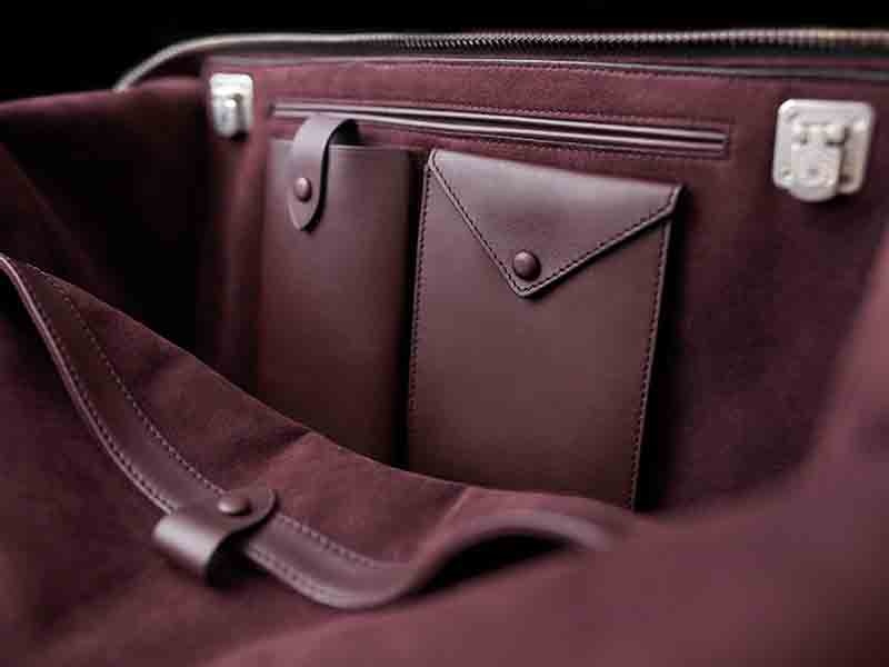 The interior linings of LONB's bags are made from Alcantara in its house color: amarone.