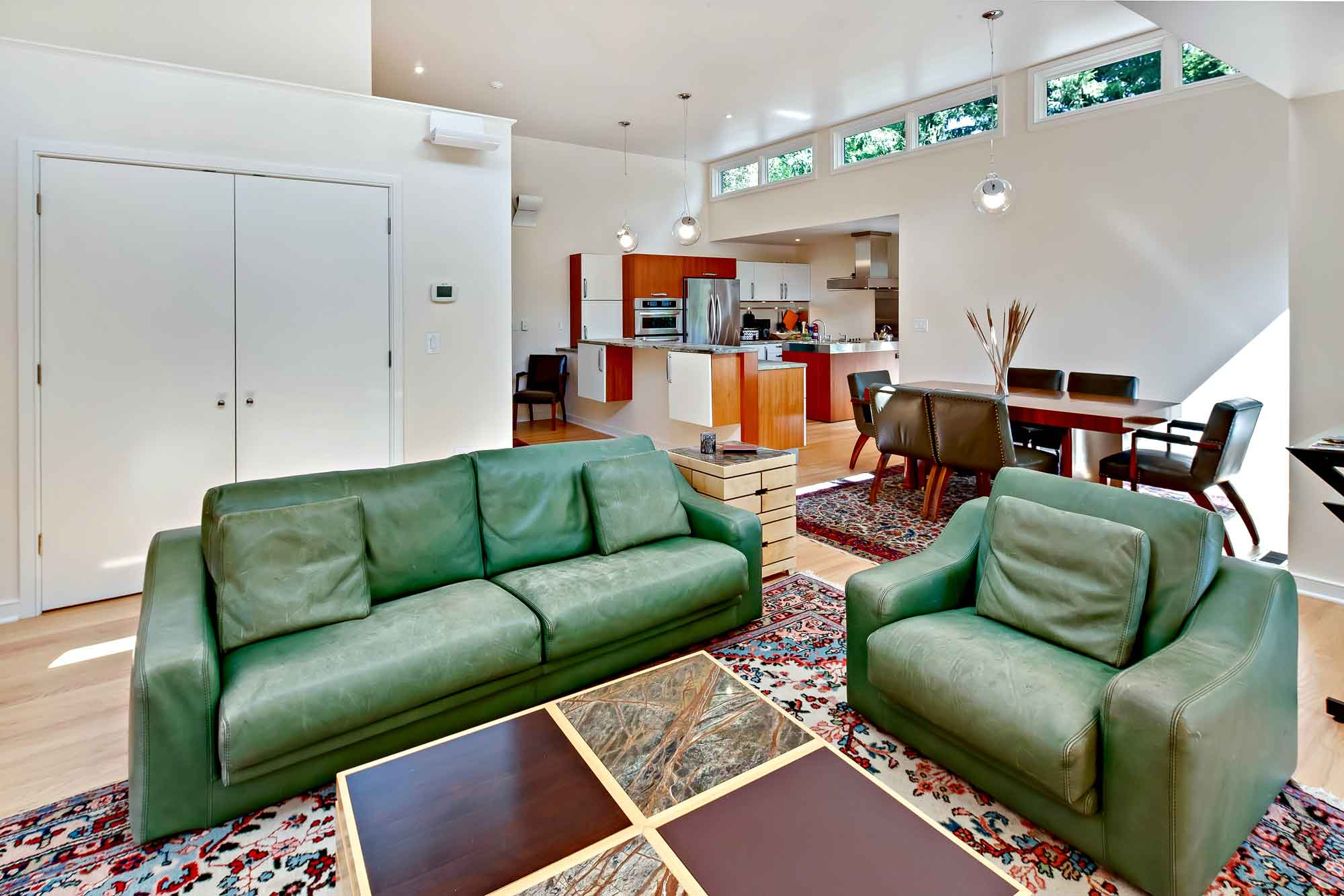 At La Maison de Verre, a striking Frank Lloyd Wright-inspired home in Princeton, New Jersey, residents and guests are accommodated in style and luxury. The home's luxurious private quarters include two master wings, two en suite bedrooms, and a 1,400-square-foot, two-bedroom apartment with a cathedral ceiling and all of the same high-end finishes as the main residence.