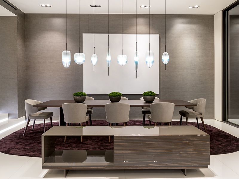 Having a dedicated dining space doesn't necessarily mean having a separate room. At 1231 Lago Vista Drive in Beverly Hills, the dining area merges with the sitting room, where glass doors open out onto a sun terrace. Photograph: Hilton & Hyland