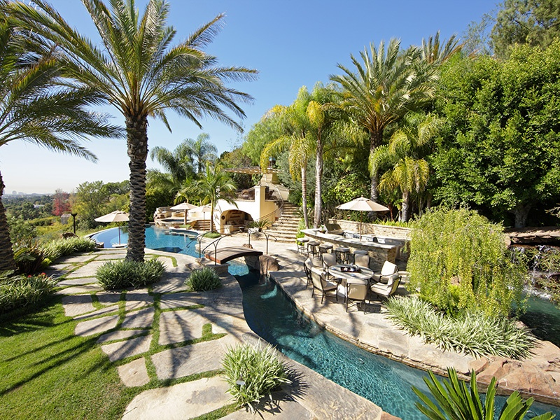 The award-winning Landry Design Group creates luxurious custom residences in a wide variety of styles. Dramatic but practical swimming pools are part of their bespoke design service.