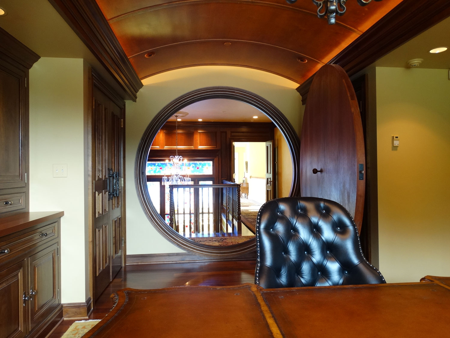The manor house at Hidden Meadows Farm has two secret doors: an enchanting Hobbit-style doorway leading to an office and a hidden door that reveals a secret staircase descending to the wine cellar.