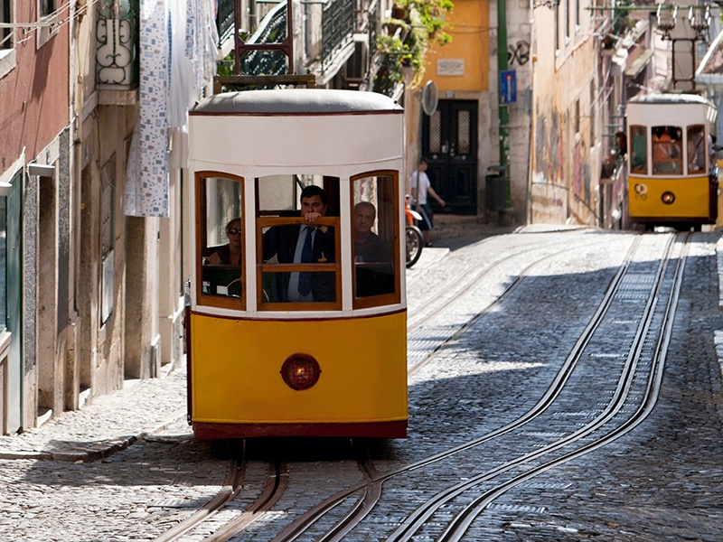 A network of old-fashioned trams winds through Lisbon's narrow streets. Photograph: Axiom Photographic