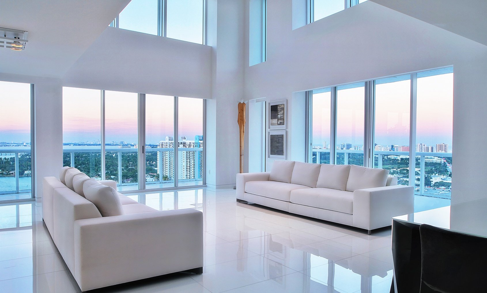 With 360-degree views of Miami Beach and the city skyline, this loft-style duplex penthouse is the quintessential South Beach retreat.