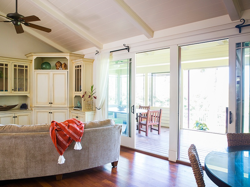 An open-concept layout features hand-crafted finishes, and creates a relaxed, welcoming ambience, while the screened-in lanai facilitates easy indoor–outdoor living.