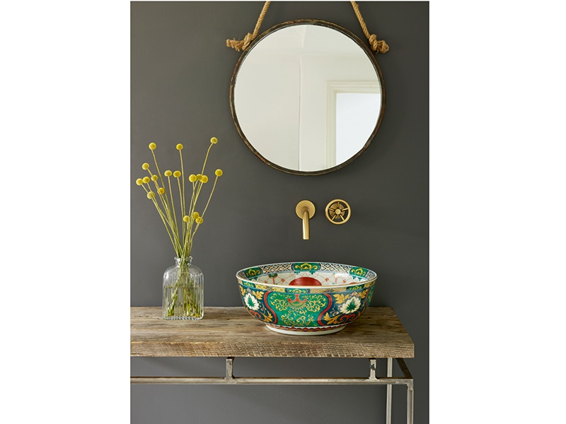The London Basin Company's sophisticated Adriana design features intricate patterns set against an emerald-green and dark-blue background, with chic gold highlights. Banner image: London Basin Company