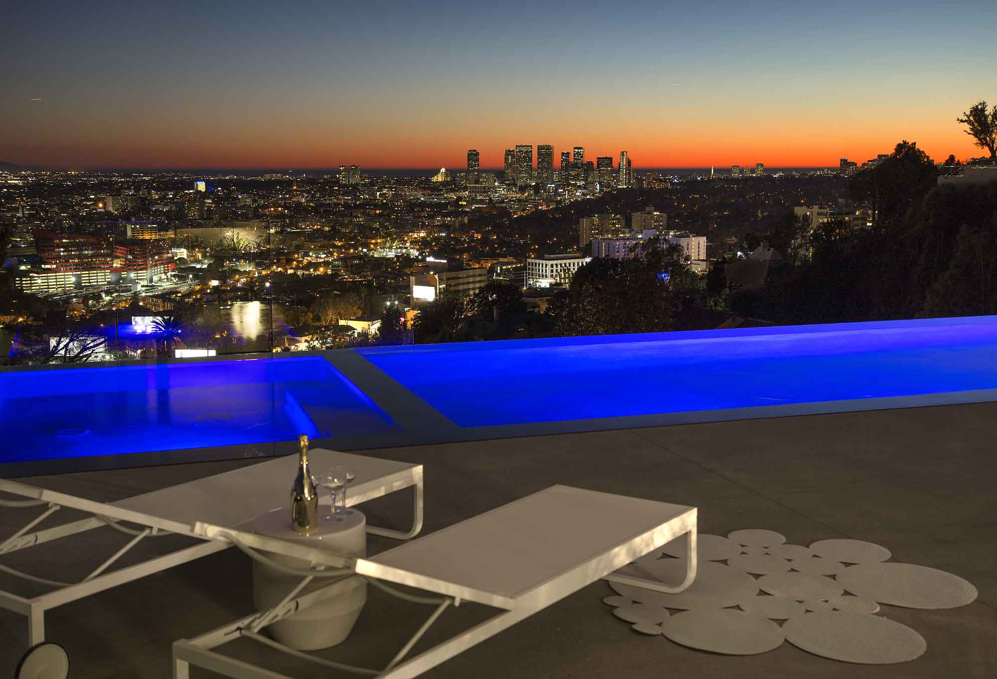 Rising up from one of the last great promontory view sites along Sunset Strip is this one-of-a-kind contemporary design by world-renowned Belzberg Architects. This home boasts explosive views spanning downtown Los Angeles all the way west to Century City and the ocean beyond.