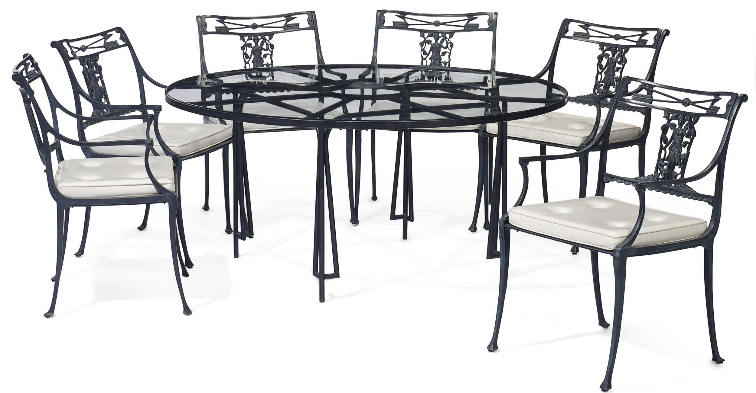 <b>A Suite of Bronze Patinated Metal Furniture</b><br/>by William Haines, Circa 1960<br/>Comprising a circular table and six armchairs