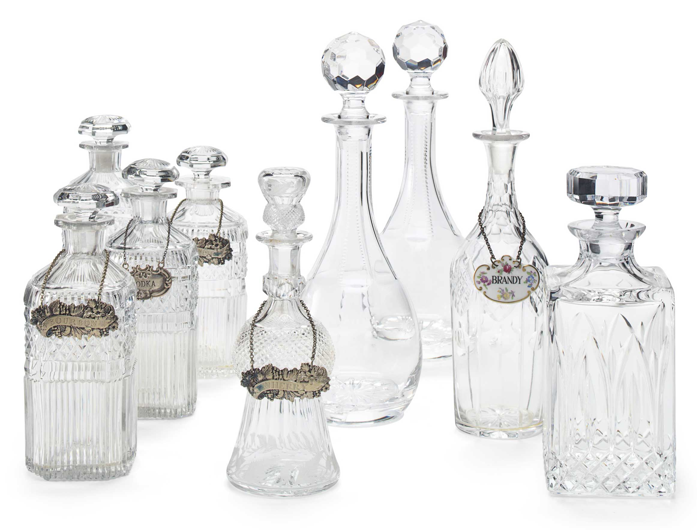 <b>A Group of Nine Cut-Glass Decanters and Stoppers</b><br/>20th Century