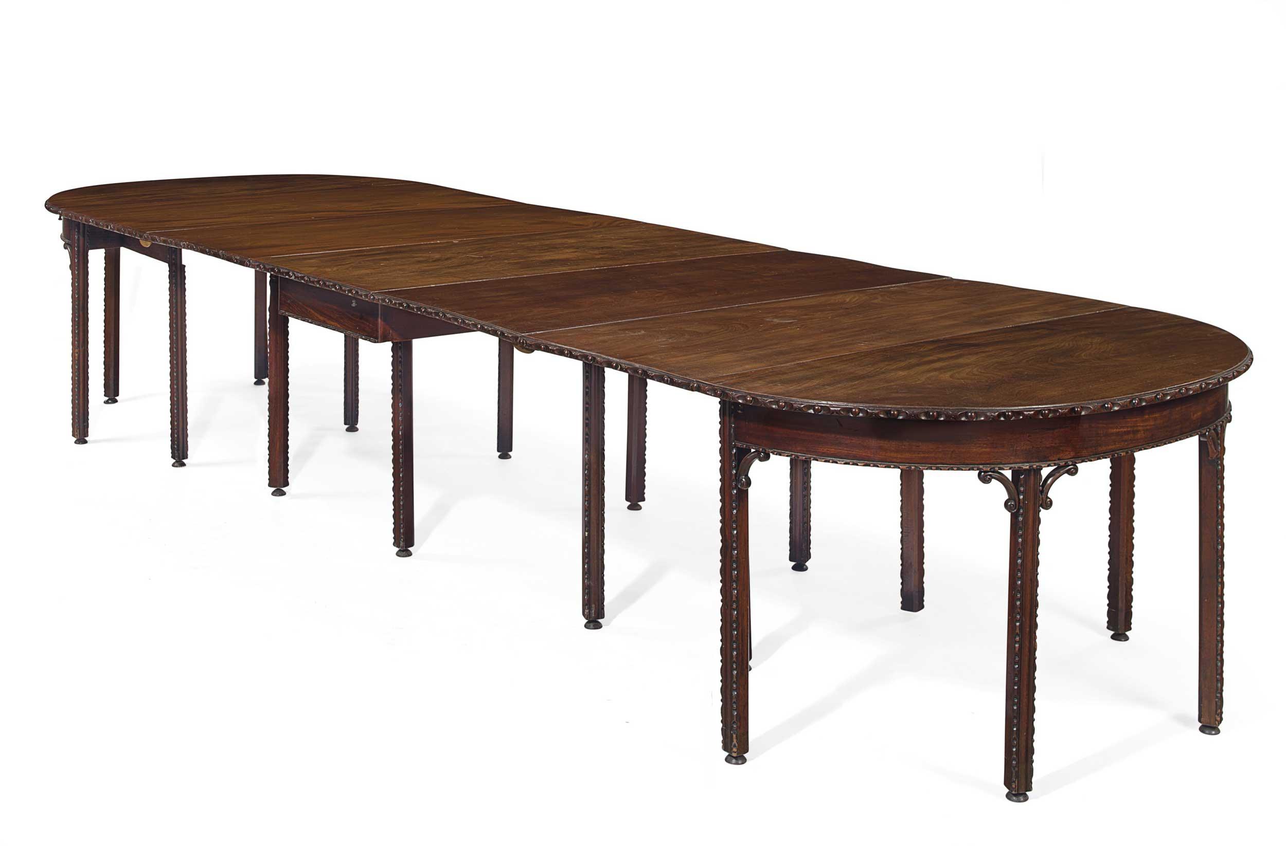 <b>An Early George III Mahogany Gate-Leg D-End Dining Table</b><br/>Circa 1760