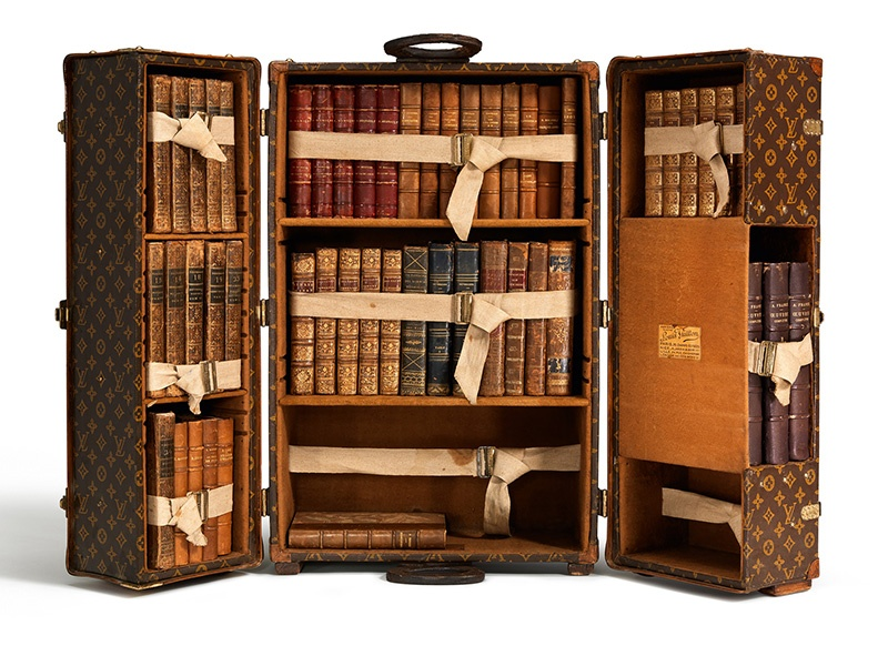 The Louis Vuitton library trunk, created in Paris in 1923 for author Ernest Hemingway, could be packed tight with books, with drawers for stationery, notebooks, and pens.