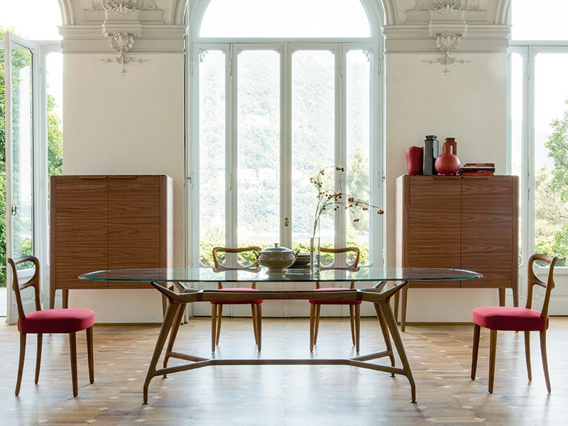 This Tarcisio Colzani-designed table, with a tempered glass top, is large enough for family get-togethers without being bulky. And the Canaletta walnut wood can be stained darker if required.