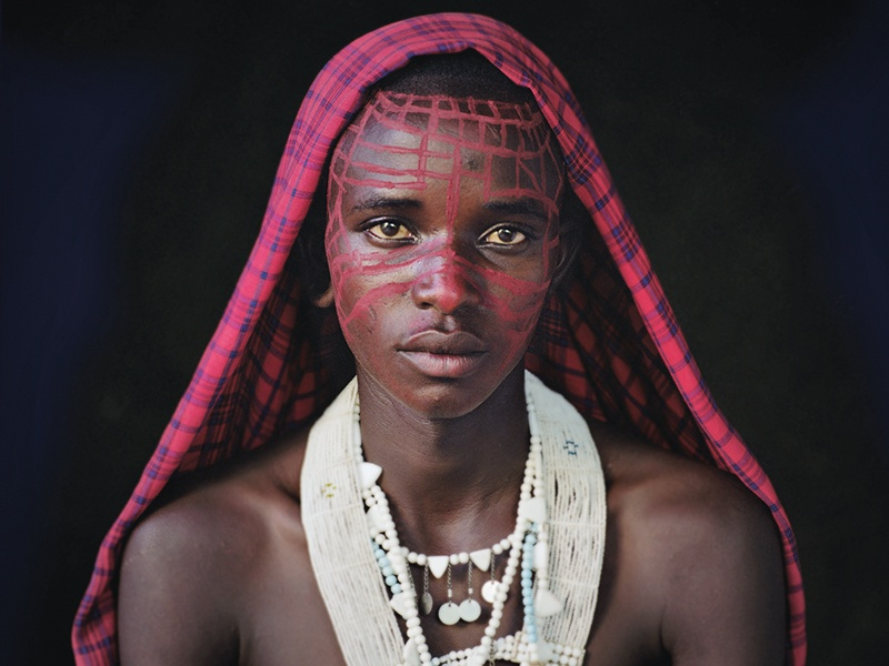 A Maasai boy of Ngorongoro, in the Serengeti, Tanzania. Through his <i>Before They Pass Away</i> project, Jimmy Nelson has sought to document indigenous people &quot;in a very iconic and beautiful way.&quot; Photograph: © Jimmy Nelson Pictures BV